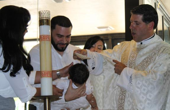 A child being baptised before he can decide for himself