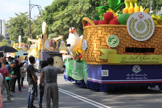 Members of the public taking photos with some of the decorated floats. photo: Ubaidillah Masli/The Scoop
