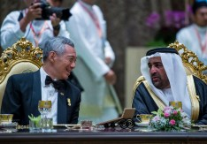 Singapore PM Lee Hsien Loong (L) and UAE Minister of State Dr Rashid Ahmad bin Faud. Photo: Infofoto