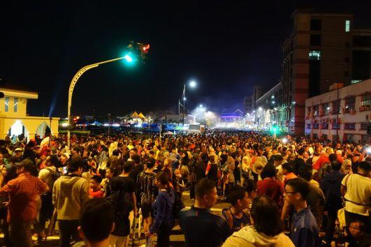 Thousands of people mill around the streets of Bandar Seri Begawan on Oct 14, to witness the opening of the Raja Isteri Pengiran Anak Hajah Saleha Bridge. Photo: Rachel Thien