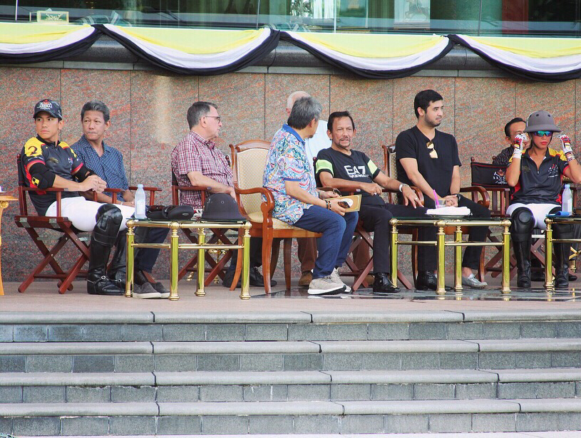 His Majesty relaxes with members of the Brunei and Johor royal families as he watches the Golden Jubilee polo tournament in Jerudong. Photo: Ubaidillah Masli