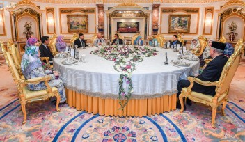 Their Majesties (C) host an afternoon tea for the Prince of Wales (6L) and Duchess of Cornwall (6R) at Istana Nurul Iman. Photo: Infofoto