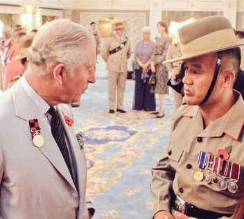 HRH Prince Charles in conversation with an officer of the Royal Gurkha Rifles at Istana Edinburgh. Photo: Ain Bandial/The Scoop