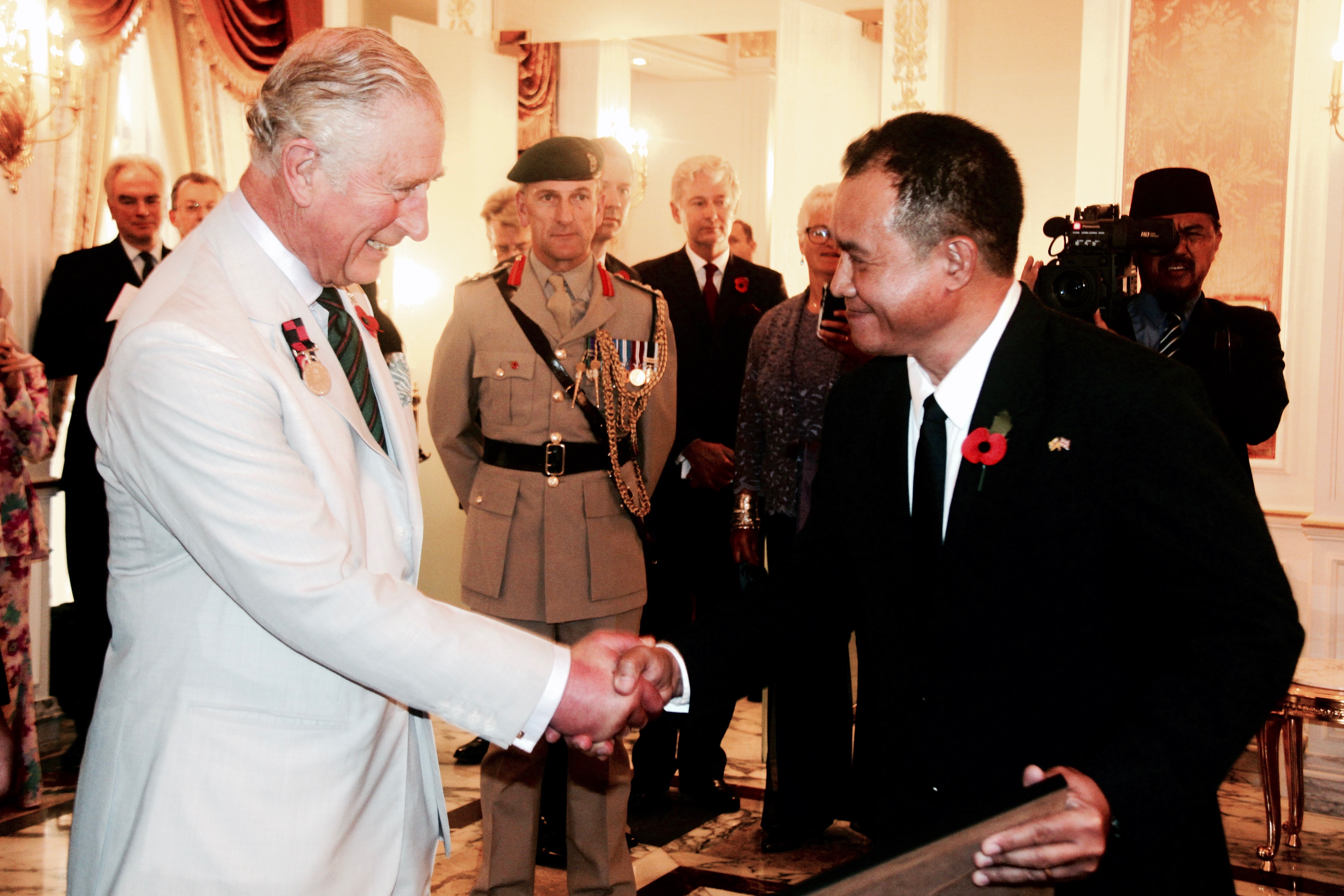 HRH Prince Charles presents a long-service award to Virgilio Mercurio Baluyot for 25 years of service as a driver to the British High Commission in Brunei . Photo: Courtesy of the British High Commission