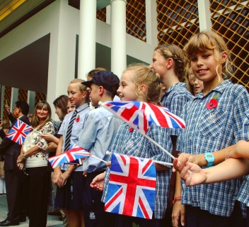 Students of International School Brunei await the arrival of Prince Charles and Camilla at Istana Edinburgh. Photo: Ain Bandial/The Scoop