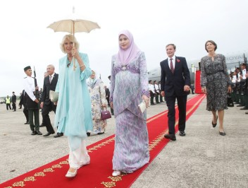 The Duchess of Cornwall is accompanied by HRH Princess Sarah upon arriving in Brunei. Photo: Courtesy of Clarence House