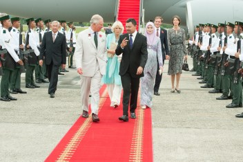 HRH Prince Haji Al-Muhtadee Billah welcomes Prince Charles and Camilla at Brunei International Airport. Photo: Infofoto