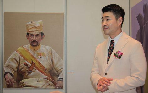 Artist Park Jin Woo poses next to his portrait of HM the Sultan. Photo: Rasidah Hj Abu Bakar/The Scoop