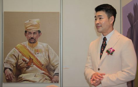 Artist Park Jin Woo poses next to his portrait of HM the Sultan. Photo: Rasidah Hj Abu Bakar/The Scoop