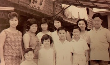Lim Kui Eng with her children and relatives in front of the first Hua Ho shop. Photo: Courtesy of the Lau Family