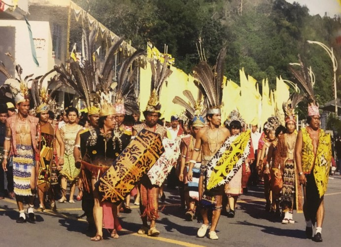 Members of the Iban tribe participate in the first National Day parade. Photo via Brunei History Centre/Infofoto
