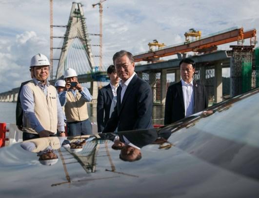 President of the Republic of Korea Moon Jae-in (C) arrives at the Temburong Bridge construction site in Kota Batu on March 11, 2019. Korean firm Daelim Industrial is one of the main contractors for the $1.4 billion bridge. Photo: Rudolf Portillo