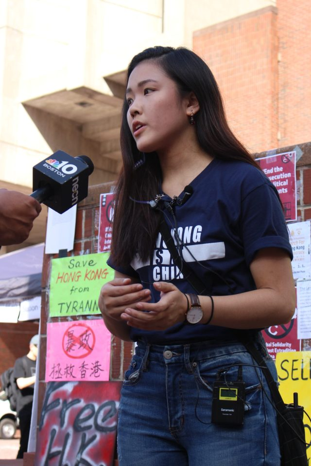 Emerson student and event organizer, Frances Hui, 19, spoke in support of the Hong Kong Human Rights Act currently being debated in Congress. Photo by Lex Weaver.