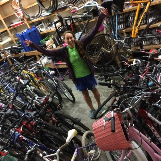 A volunteer stands in CommonWheels' storage facility until they were forced to relocate. Photo courtesy of CommonWheels' Facebook page.