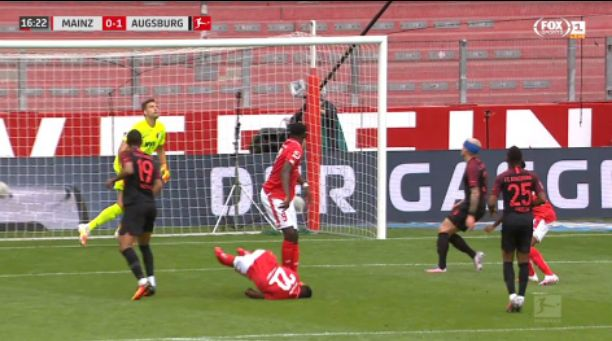 Nigeria forward Taiwo Awoniyi collapses after suffered a heavy collision from opponent in Bundesliga game