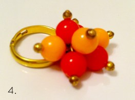 Red and orange bead ring. Bought at a vintage store.