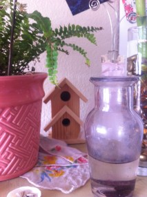 #4: Create a special place on a shelf with wooden birdhouses, patterned handkerchiefs, photographs, and plants to create a sort of indoor garden.