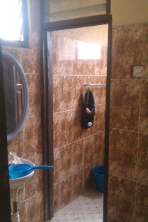 My Bathroom. I have a mirror! I don't have a plug for my sink though so I use the container there so I can wash my face etc.