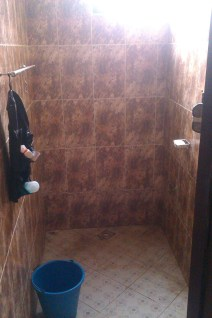 My bathing room. You can't see the shower head but you can see the tap and bucket I use.