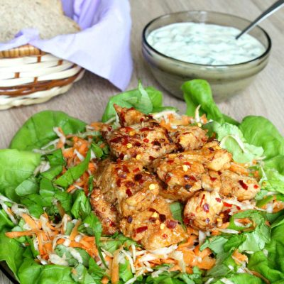 Yummy and healthy spicy chicken salad with root vegetables and yogurt mustard sauce