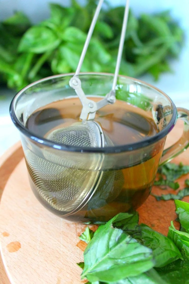 Image of a cup of fresh basil tea, made following the below instructions on how to make basil tea