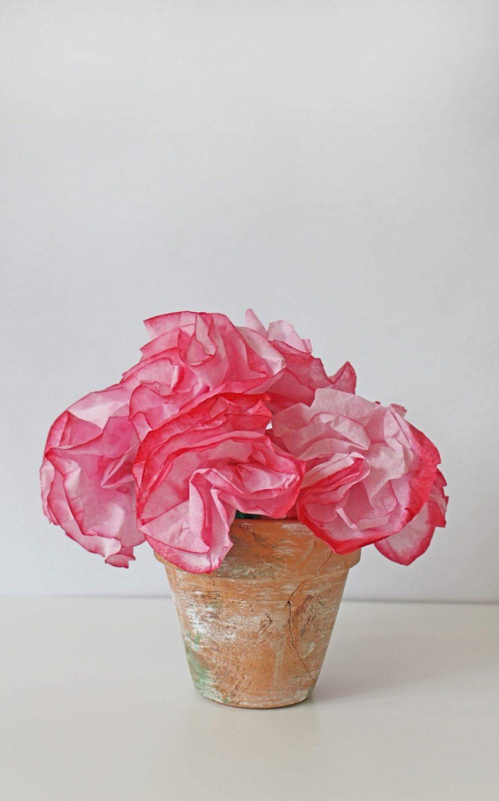 Bouquet of coffee filter flowers in a terracotta flower pot