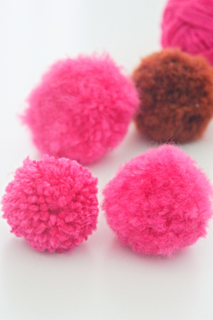 Pink fluffy pom pom