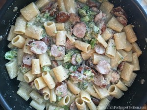 Toss ingredients together for sausage alfredo