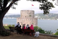 A small group of Muslim ladies peruse the view from the summit of Rumeli Hisari (fortress).