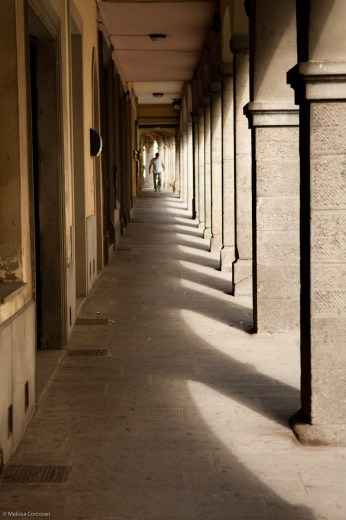Loggia defined by light and shadow in Pratovecchio.