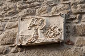 Plaque above a doorway.