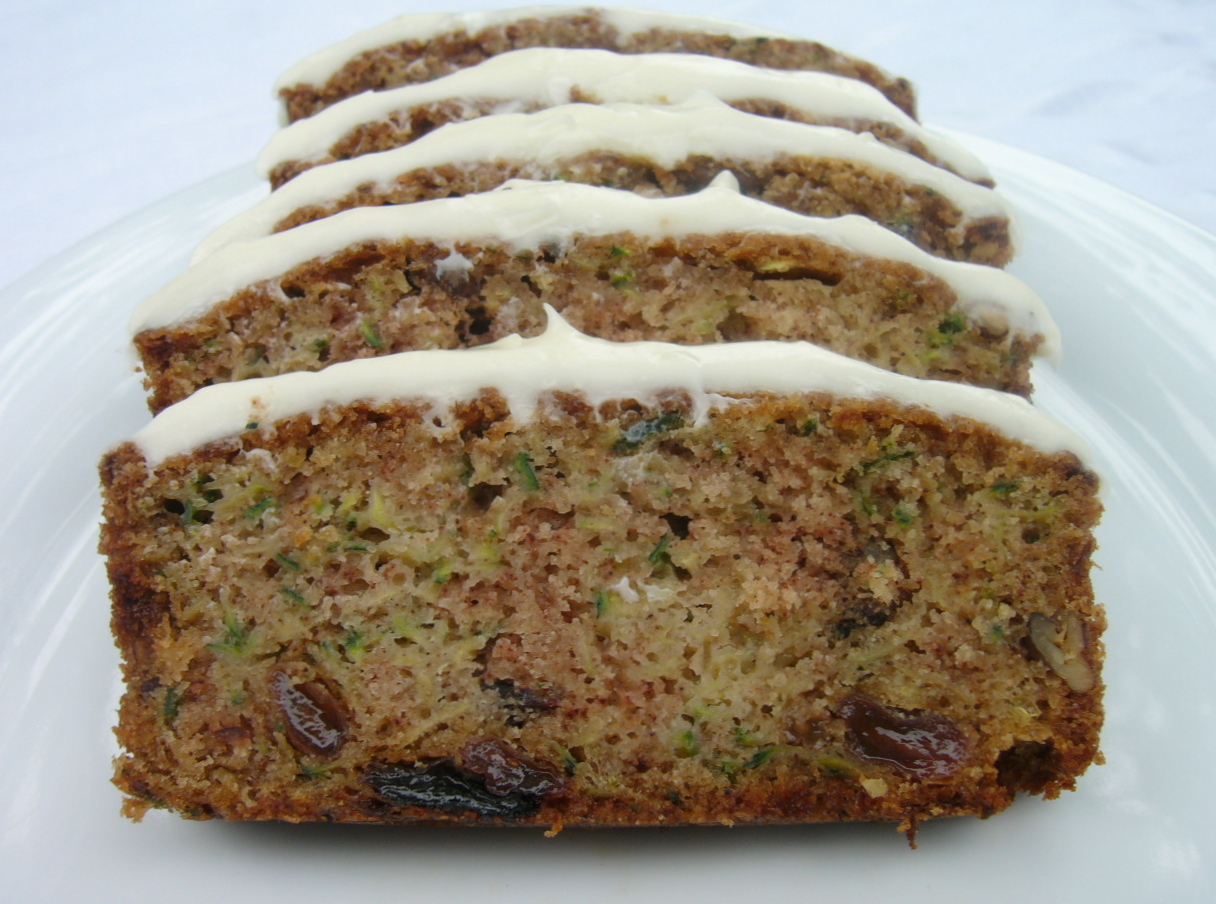 Zucchini Bread with Cream Cheese Frosting, cut into slices