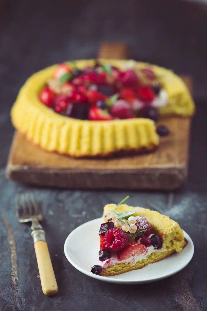 Summer Berry Sponge Flan with Blackcurrant and Apple Jelly Cubes -- Finish with a very light dusting of icing sugar | https://theseasonaltable.co.uk/uncategorized/summer-berry-sponge-flan-with-blackcurrant-and-apple-jelly-cubes