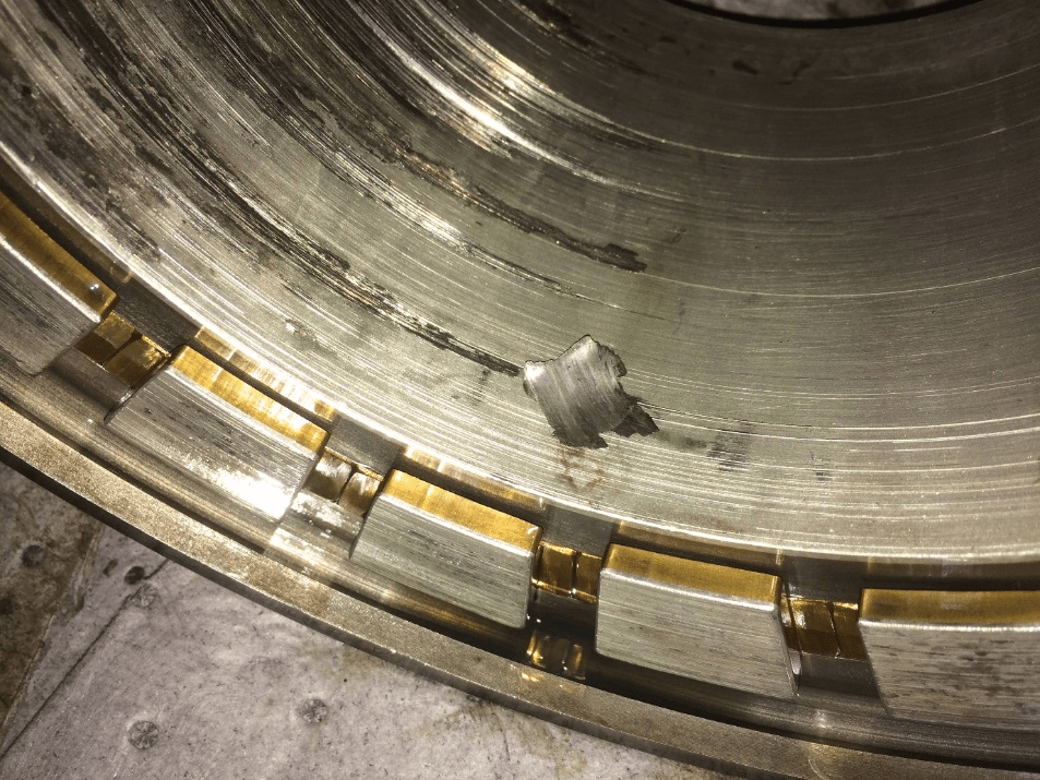 A Fan Sleeve bearing defect found with an Accelerometer and oil analysis - Case Study