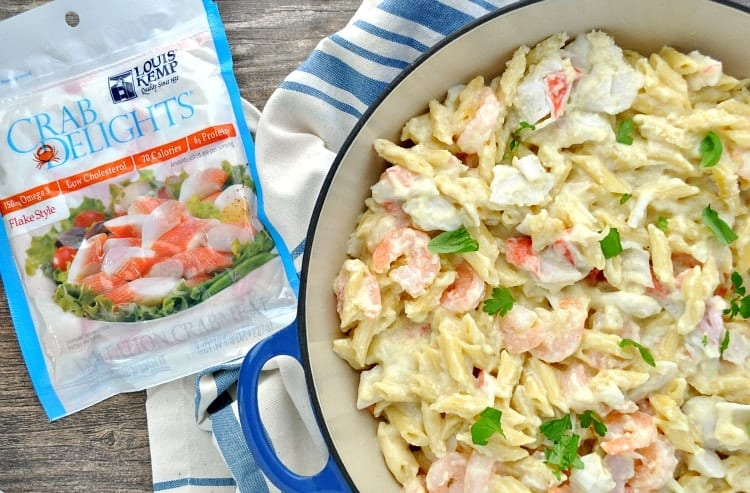 Get a healthy dinner on the table fast with this One Skillet Skinny Seafood Alfredo! Even the pasta cooks right in the pan for this easy weeknight meal!