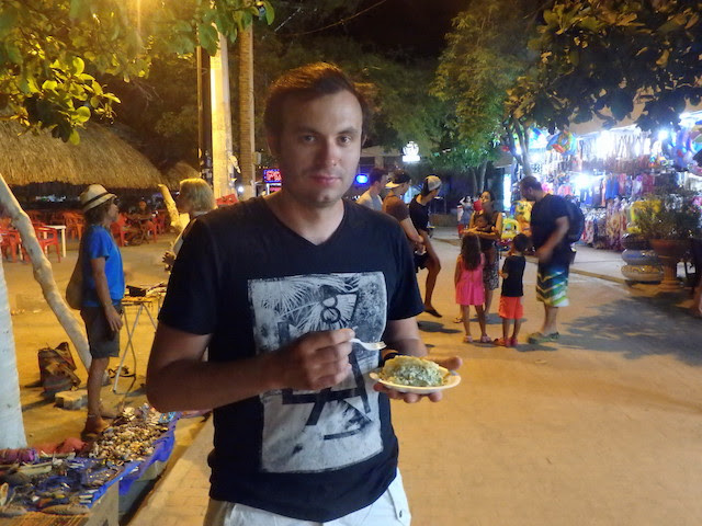 Eating arepa in Taganga, Colombia