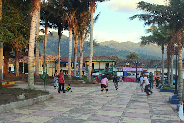 Children playing volley in the main square of Salento, Colombia