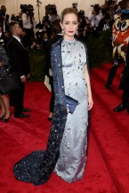 Emily Blunt wears a Prada dress and Anna Hu Haute jewellery