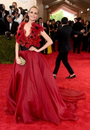 Poppy Delevingne wears a Marchesa gown