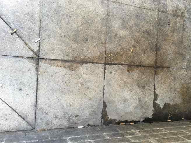 Soho pavement piss-streaked