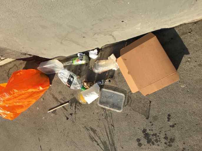 Soho pavement litter-lawned