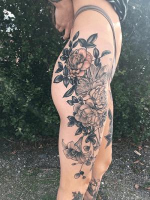 Floral tattoo along leg