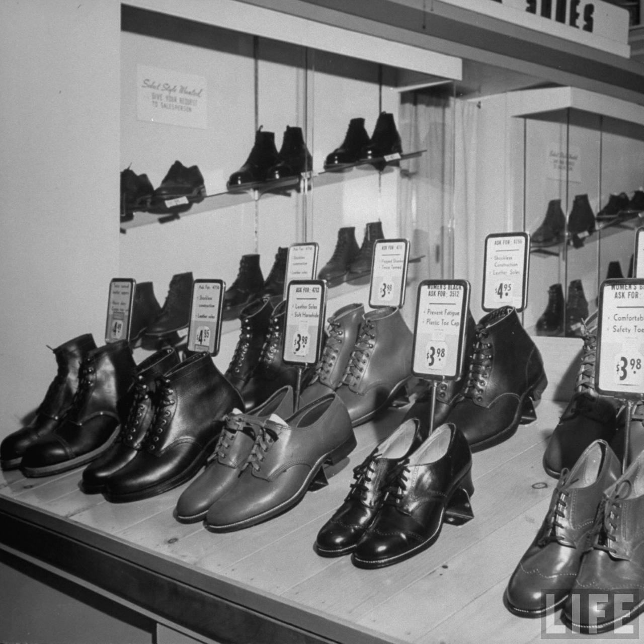 Shoes being displayed for sale in a Sears Roebuck store. --West Alis, WI 1943