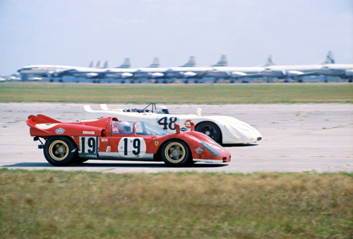 On the long airport straight at Sebring we see the #48 Porsche 980/02 of Steve McQueen and Peter Revson. The red #23 Ferrari 312PB was driven by Tony Adamowicz and Luigi Chinetti. The car that looks like it is trying to come up between the Porsche and Ferrari is the #73 Austin-Healey Sprite driven by Janet Guthrie, Rosemary Smith and Judy Kondratiff. To the far left is the #47 Porsche 908/02 of Hans Laine and Gijs van Lennep. Only two cars finished the race. The McQueen Porsche finished 2nd and the Guthrie Austin-Healey finished 19th. Note: This Austin-Healey Sprite body style became known as the Sebring Sprite.