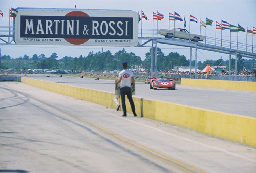 The Martini & Rossi vehicle bridge just yards from the start/finish line. The car in the picture is the #19 Ferrari of Mario Andretti and Arturo Merzario. The car was leading at the time I took the photo. The car had mechanical problems later and Andretti jumped to the #21 Ferrari 512 for the win just 22 seconds ahead of Steve McQueen and Peter Revson's Porsche.