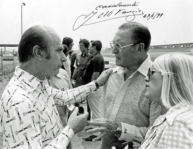 An autographed photo given by the great Formula 1 driver Juan Fangio to Harold Cole of New Smyrna Beach, Fl when Fangio made a visit to the Daytona Speedway in 1979.  Love the crazy printed shirts, especially the incredible equestrian horse-bit motif on the left-- very Hermes chic.