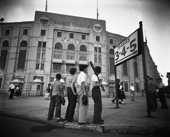 "Original caption -- ""The Youngsters Pay Their Respects."" Though too young to have ever seen Babe Ruth play ball, these 4 youngsters wandered down to Yankee Stadium on completion of their neighborhood ball game, to pay their respects to the beloved athlete. They are shown outside Yankee Stadium, on their way to join the thousands who entered the rotunda of the great sports arena to pay their last respects to baseball's greatest figure. -- Aug. 17th, 1948."