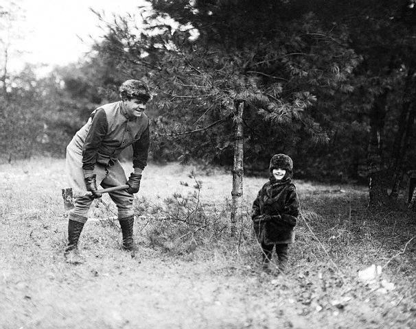 Original caption -- Babe Ruth with daughter Dorothy, now four years old on his farm at Sudbury, Massachusetts. -- Dec. 22nd, 1924.