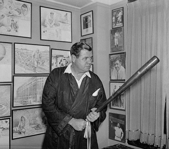 , New York, USA  -- Baseball's Forgotten Man. New York, New York: Babe Ruth waving the sceptre he carried when he was acclaimed as king of baseball. Baseball's most colorful character is now leading the life of a private citizen in his New York apartment and will go south this year as a private citizen. No spring training camp for him. -- 1 Dec 1935, Manhattan, New York.
