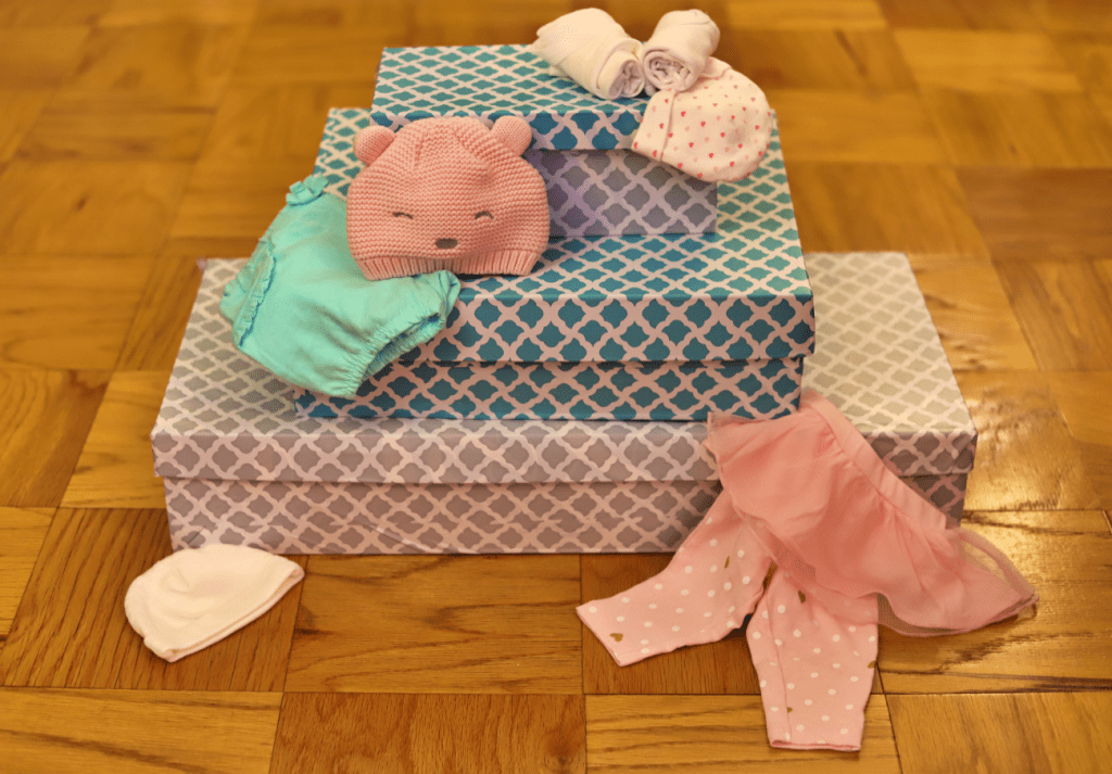 How to Store Outgrown Baby Clothes (When You Don't Have the Space)